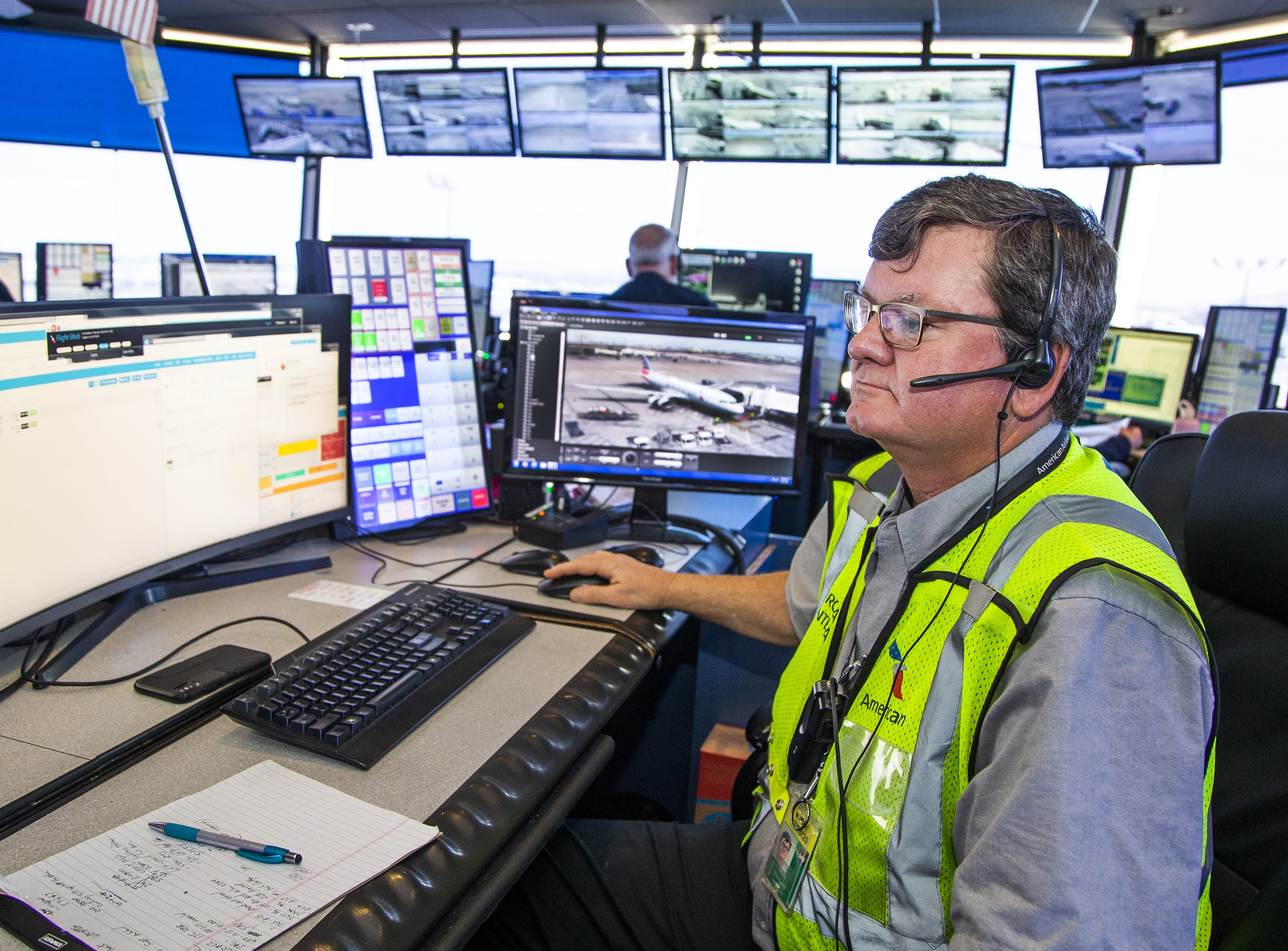 Kevin Eastlake, a maintenance supervisor for American Airlines, monitors incoming and outgoing flights from the American Airlines tower at Sky Harbor International Airport, Friday, May 10, 2019.