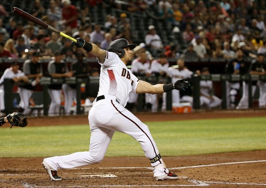 Arizona Diamondbacks' David Peralta connects for a run-scoring double against the Pittsburgh Pirates during the second inning of a baseball game Monday, May 13, 2019, in Phoenix.