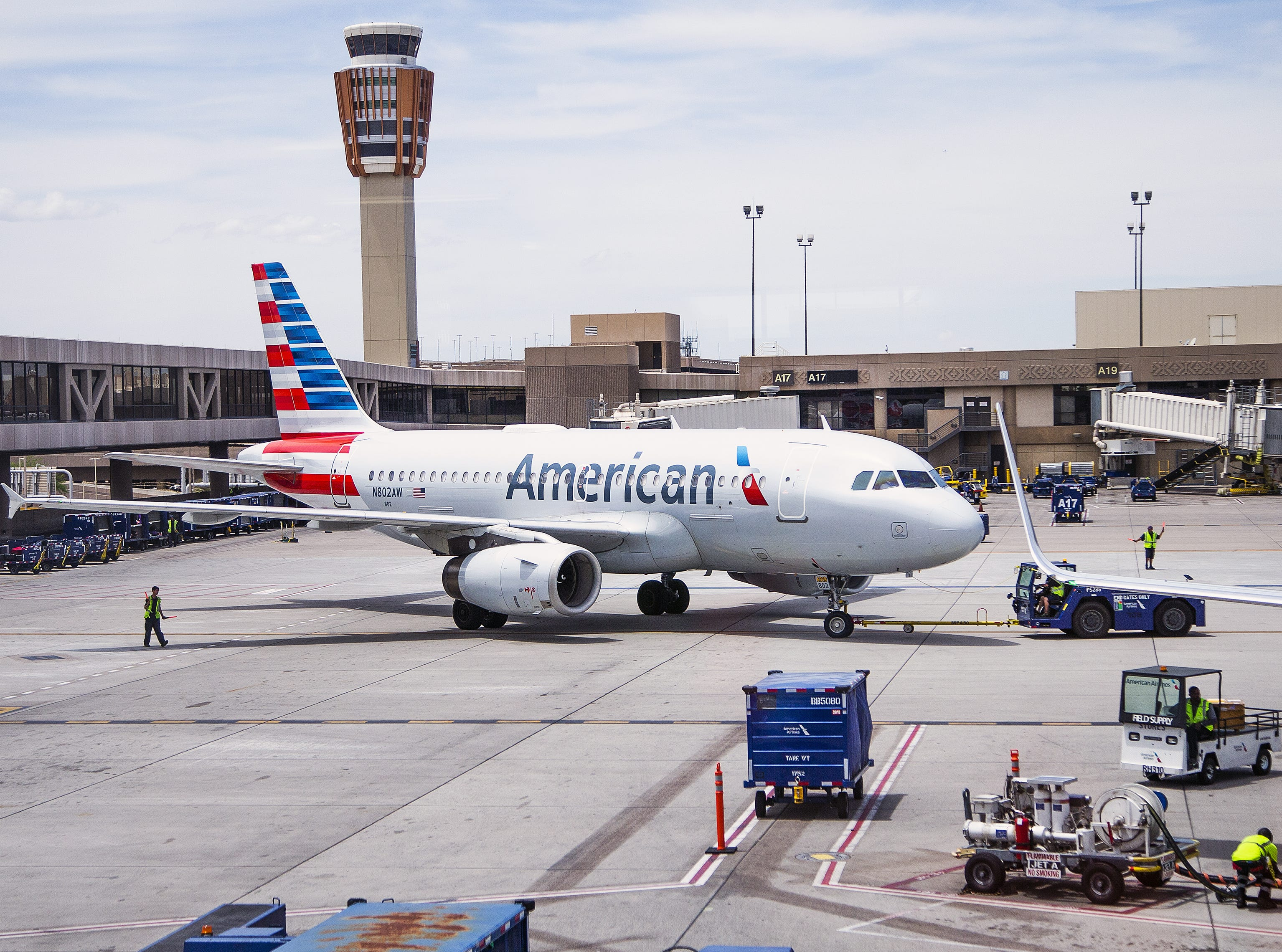 An American Airlines Airbus A-319 pulls away from the gate at Sky Harbor International Airport in Phoenix, Friday, May 10, 2019.  The flight , which arrived from Tucson, was unloaded, serviced, cleaned, reloaded and reboarded for a flight to Austin within 30 minutes.