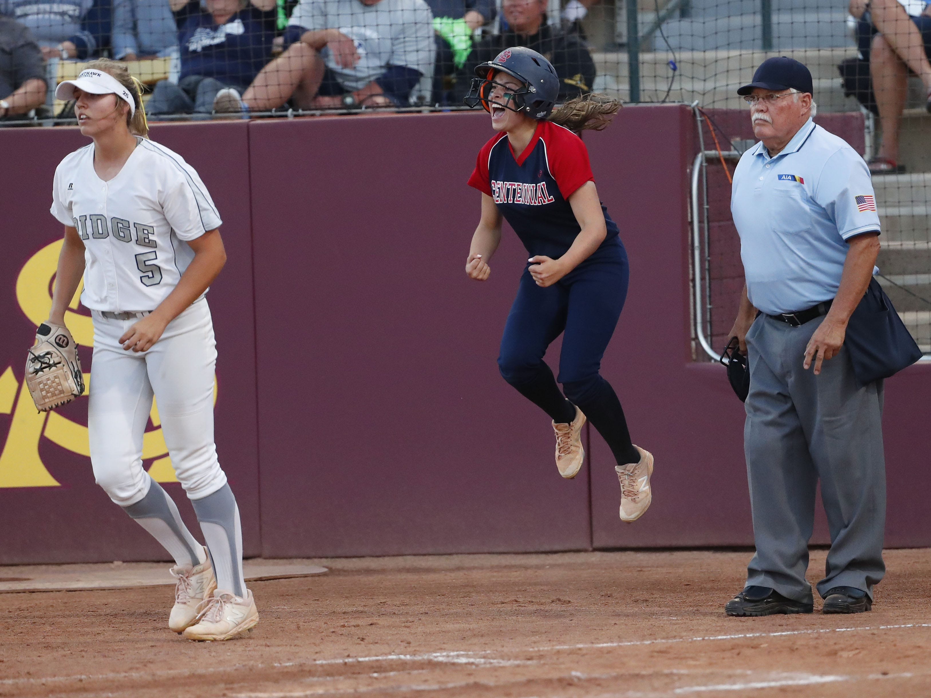 Centennial center fielder Jaydin Gonzalez celebrates after scoring against Ironwood Ridge during the 5A State Softball Championship in Tempe, Ariz. May 13, 2019.