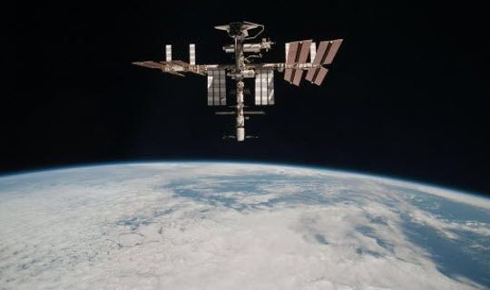 The International Space Station is at an altitude of approximately 220 miles above the Earth.