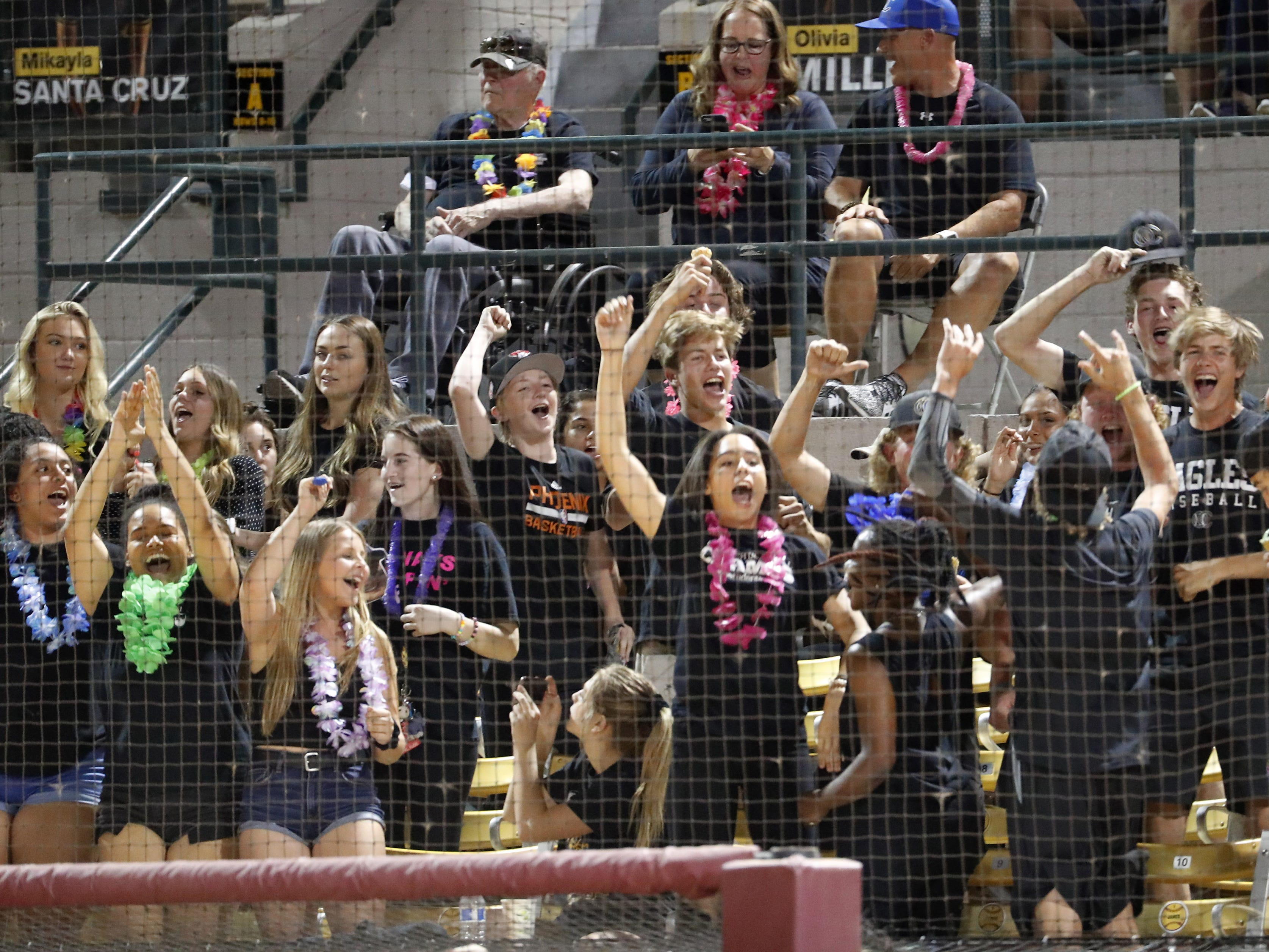 Sandra Day O'Connor students celebrate after scoring against Pinnacle during the 6A State Softball Championship in Tempe, Ariz. May 13, 2019.
