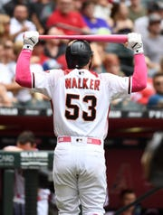 Christian Walker walks back to the dugout after striking out in the seventh inning of Sunday's Diamondbacks loss.
