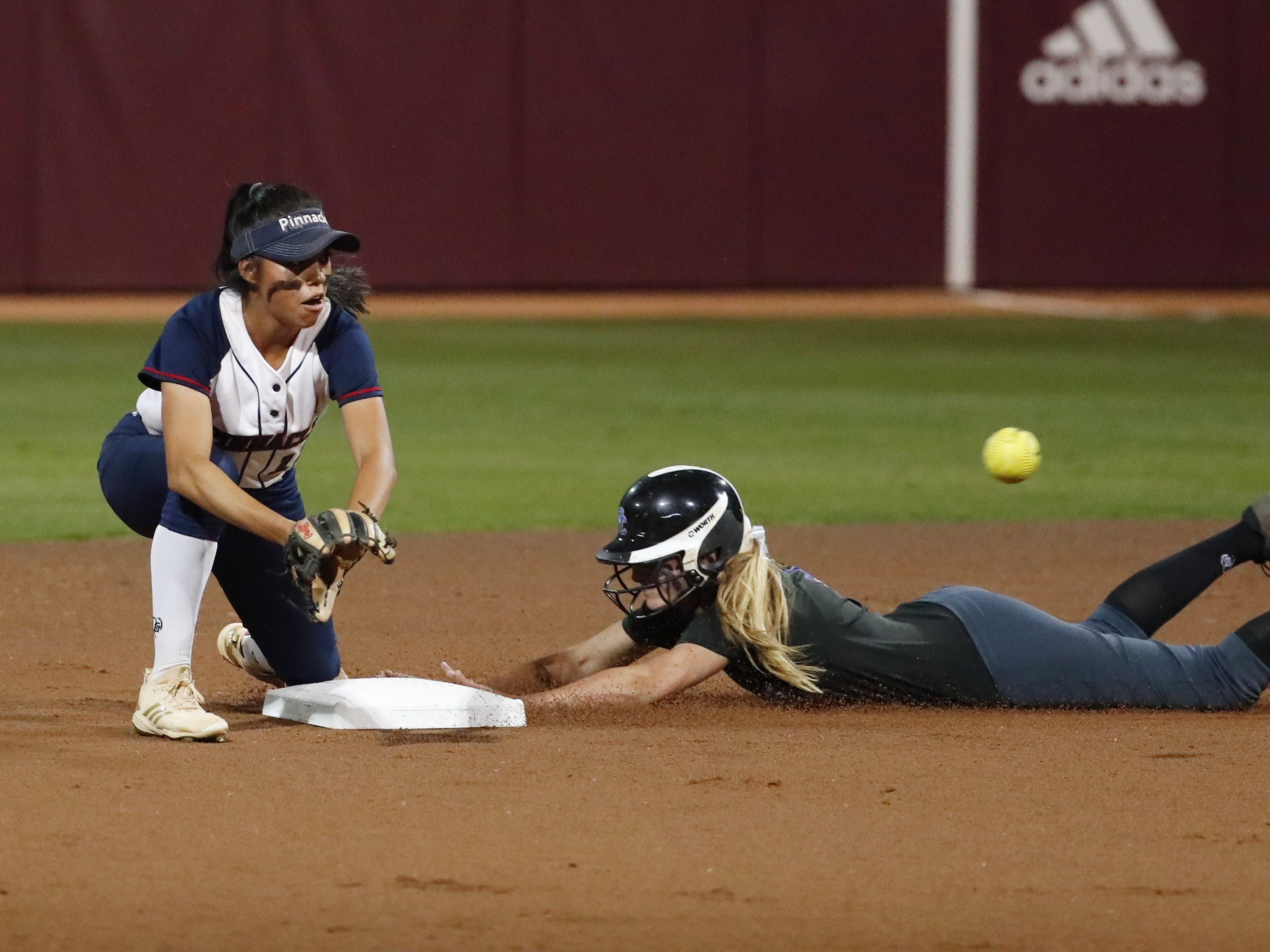 Sandra Day O'Connor's Rylee Holtorf (5) steals second base ahead of the tag by Pinnacle second baseman Tamia Yellowman (13) during the 6A State Softball Championship in Tempe, Ariz. May 13, 2019.