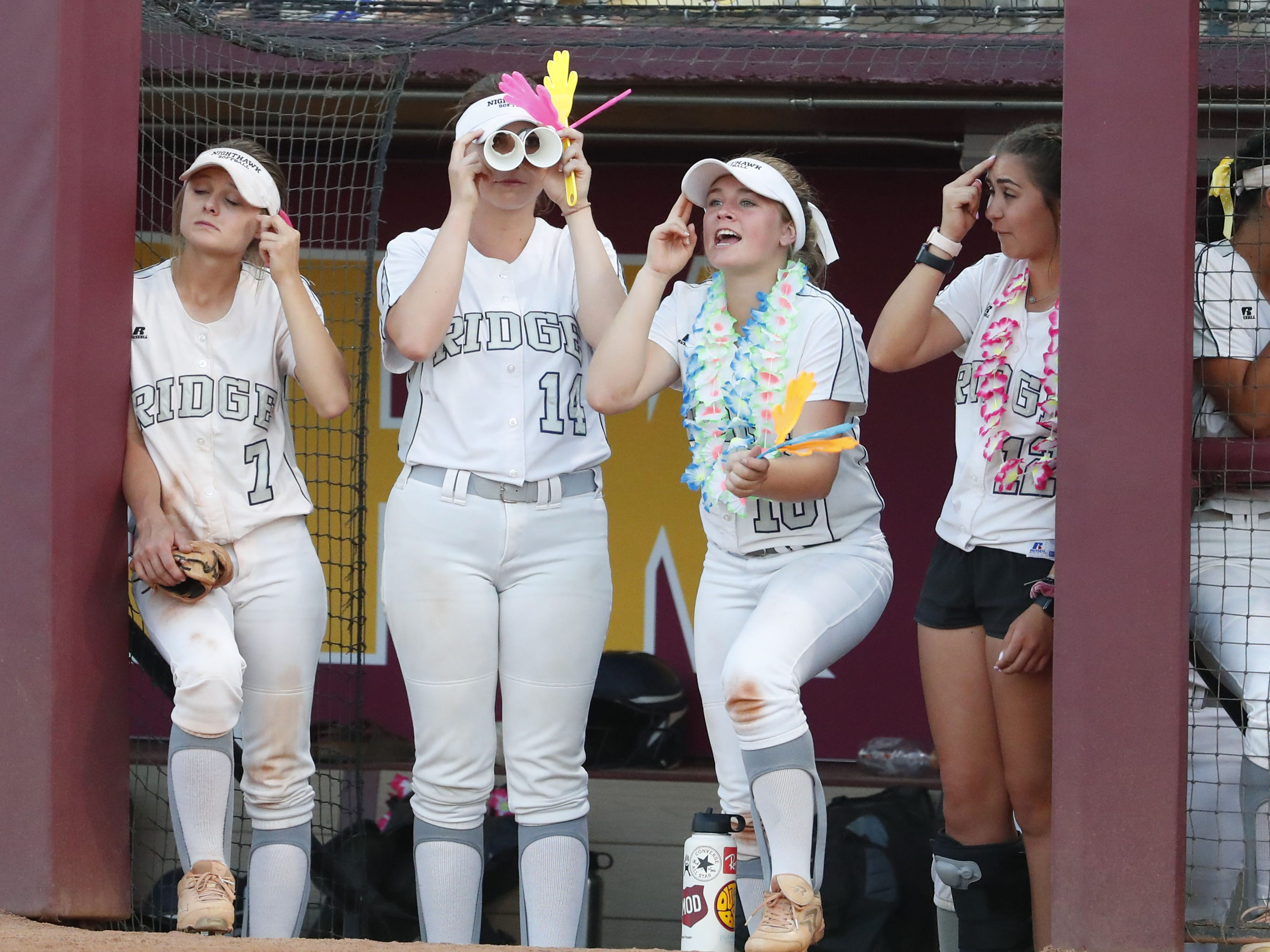 Ironwood Ridge players cheer for their teammates against Centennial during the 5A State Softball Championship in Tempe, Ariz. May 13, 2019.