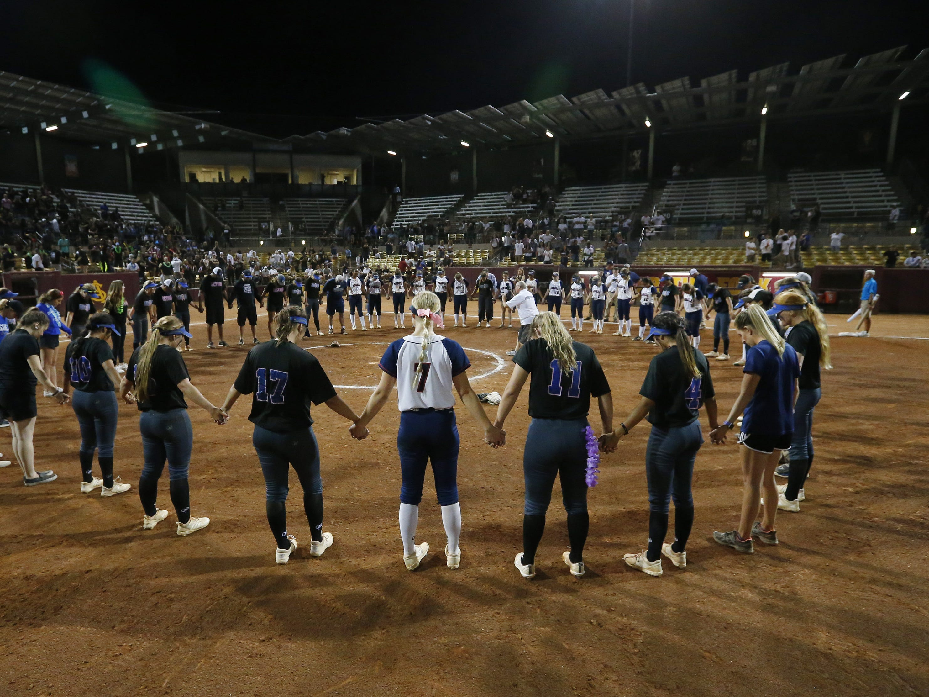 Sandra Day O'Connor an Pinnacle players pray together after the 6A State Softball Championship in Tempe, Ariz. May 13, 2019. Sandra Day O'Connor won 6-4.