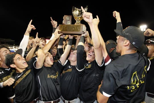 Salpointe's celebrate their 4-3 win over Mesquite during the 4A State Championship game in Mesa, Monday, May 13, 2019. Darryl Webb/Special for the Arizona Daily Star