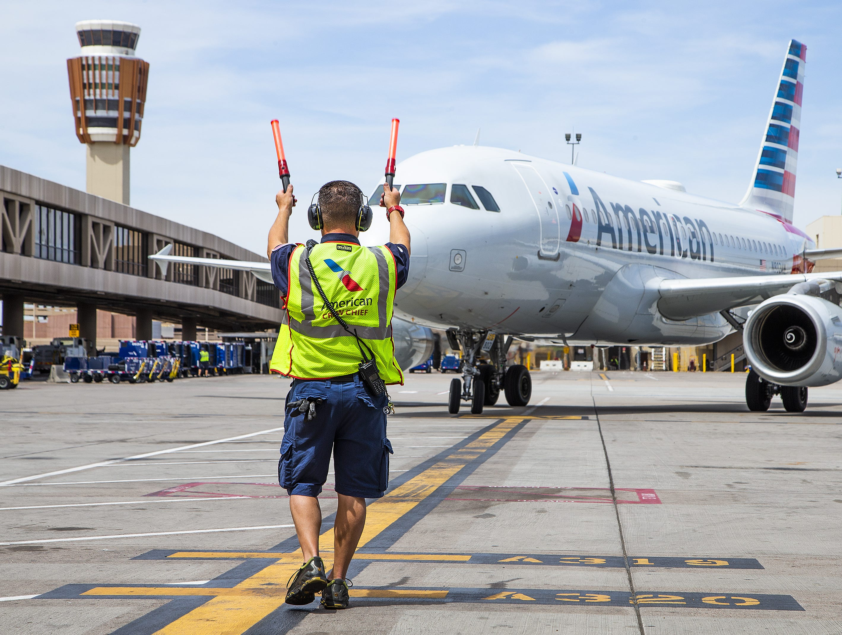 An American Airlines Airbus A-319 arrives at Sky Harbor International Airport after flying in from Tucson, Friday, May 10, 2019.  The flight would be unloaded, serviced, cleaned, reloaded and reboarded for a flight to Austin within 30 minutes.