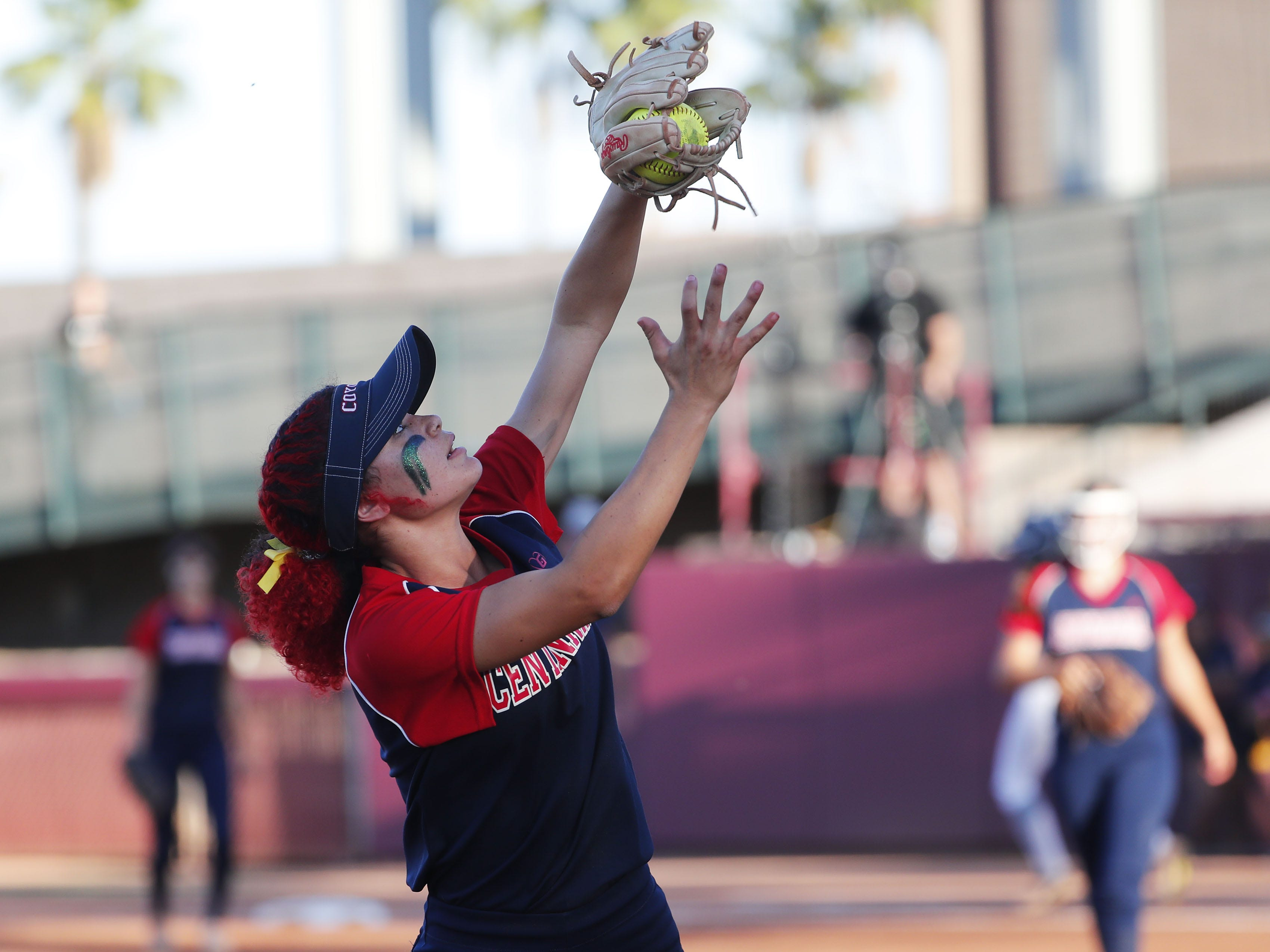 Centennial third baseman Adyson Maya (4) makes a catch against Ironwood Ridge during the 5A State Softball Championship in Tempe, Ariz. May 13, 2019.