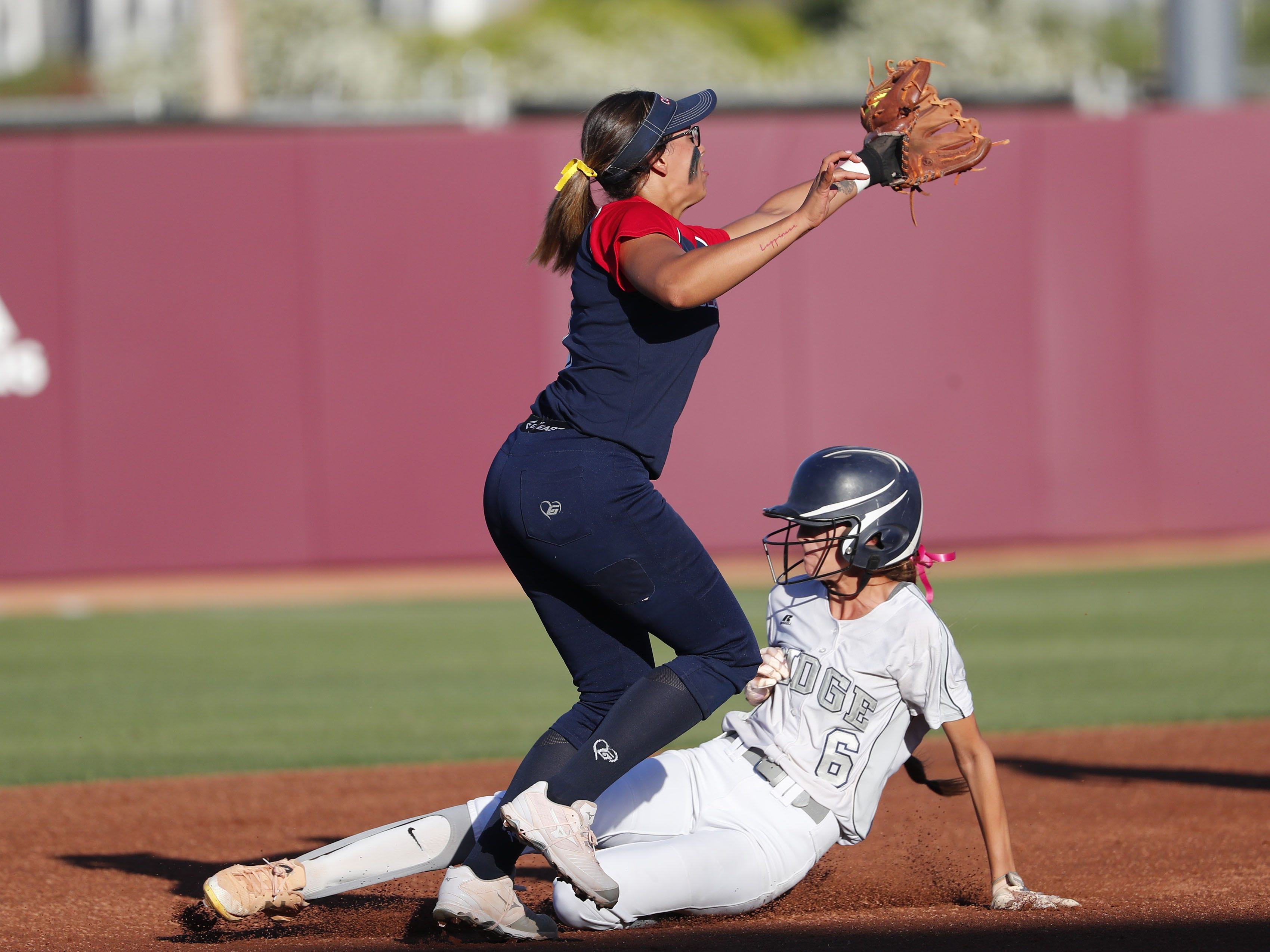 Ironwood Ridge center fielder Jaiden Reid (6) steals second base ahead of the tag by Centennial shortstop Dren Meginnis (1) during the 5A State Softball Championship in Tempe, Ariz. May 13, 2019.