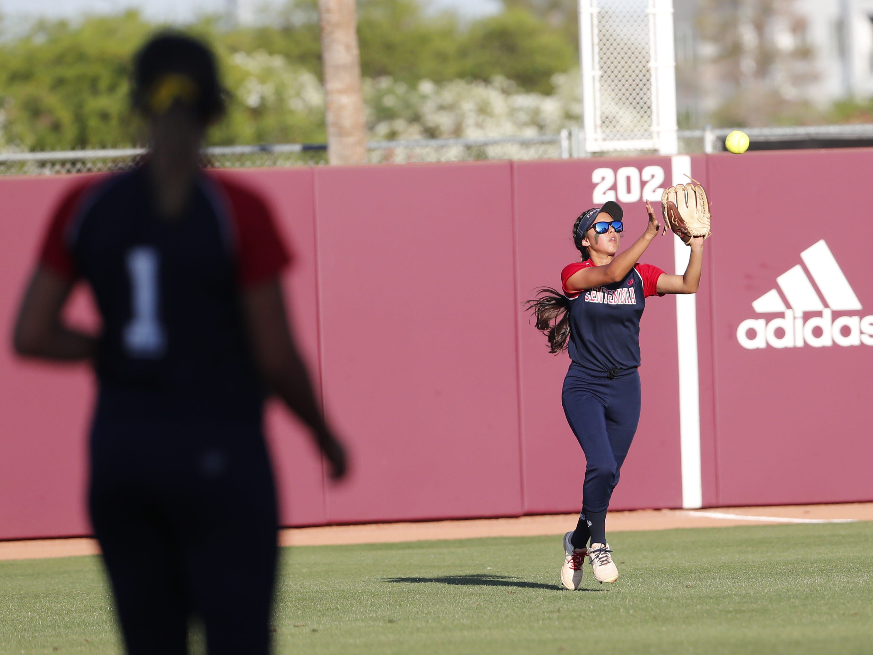 Centennial right fielder Natalie Vasquez (5) makes a catch against Ironwood Ridge during the 5A State Softball Championship in Tempe, Ariz. May 13, 2019.