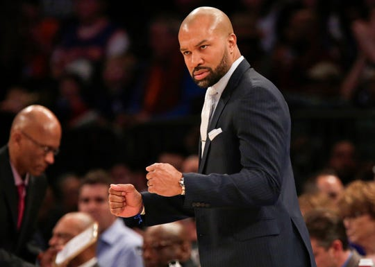 Feb 5, 2016; New York, NY, USA; New York Knicks head coach Derek Fisher reacts against the Memphis Grizzlies during the second half at Madison Square Garden. The Grizzlies defeated the Knicks 91-85. Mandatory Credit: Adam Hunger-USA TODAY Sports