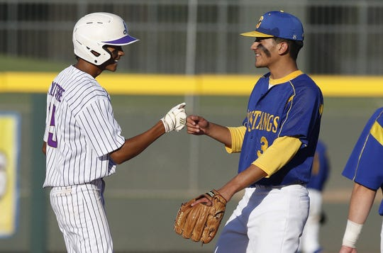 Sabino's Jake Wiltshire (left) shares a smile with Sahuarita's Jose Dicochea (right) during a timeout in the 3A State Championship in Mesa, Monday, May 13, 2019. Darryl Webb/Special for the Arizona Daily Star  Jake Wiltshire