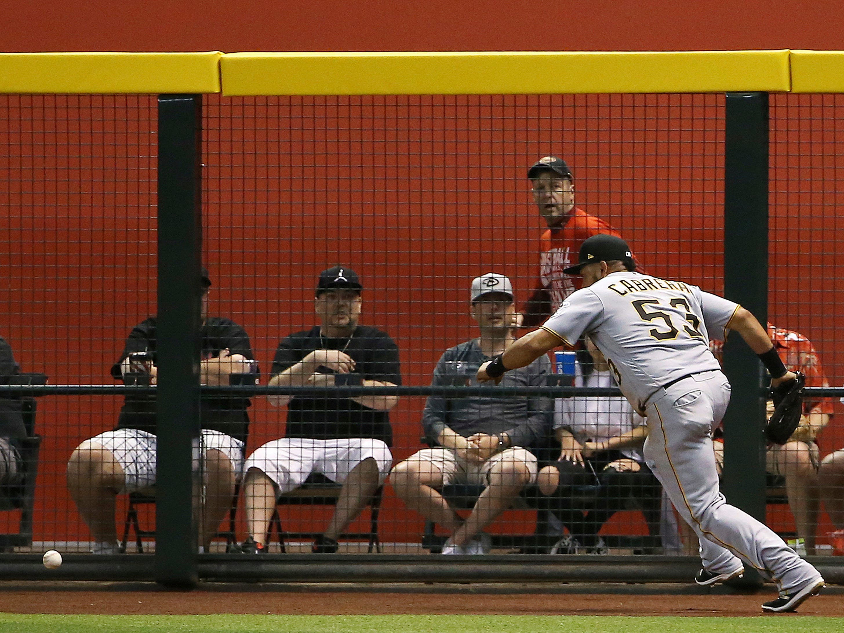 Pittsburgh Pirates right fielder Melky Cabrera tries to chase down a two-run triple hit by Arizona Diamondbacks' Eduardo Escobar during the second inning of a baseball game Monday, May 13, 2019, in Phoenix.