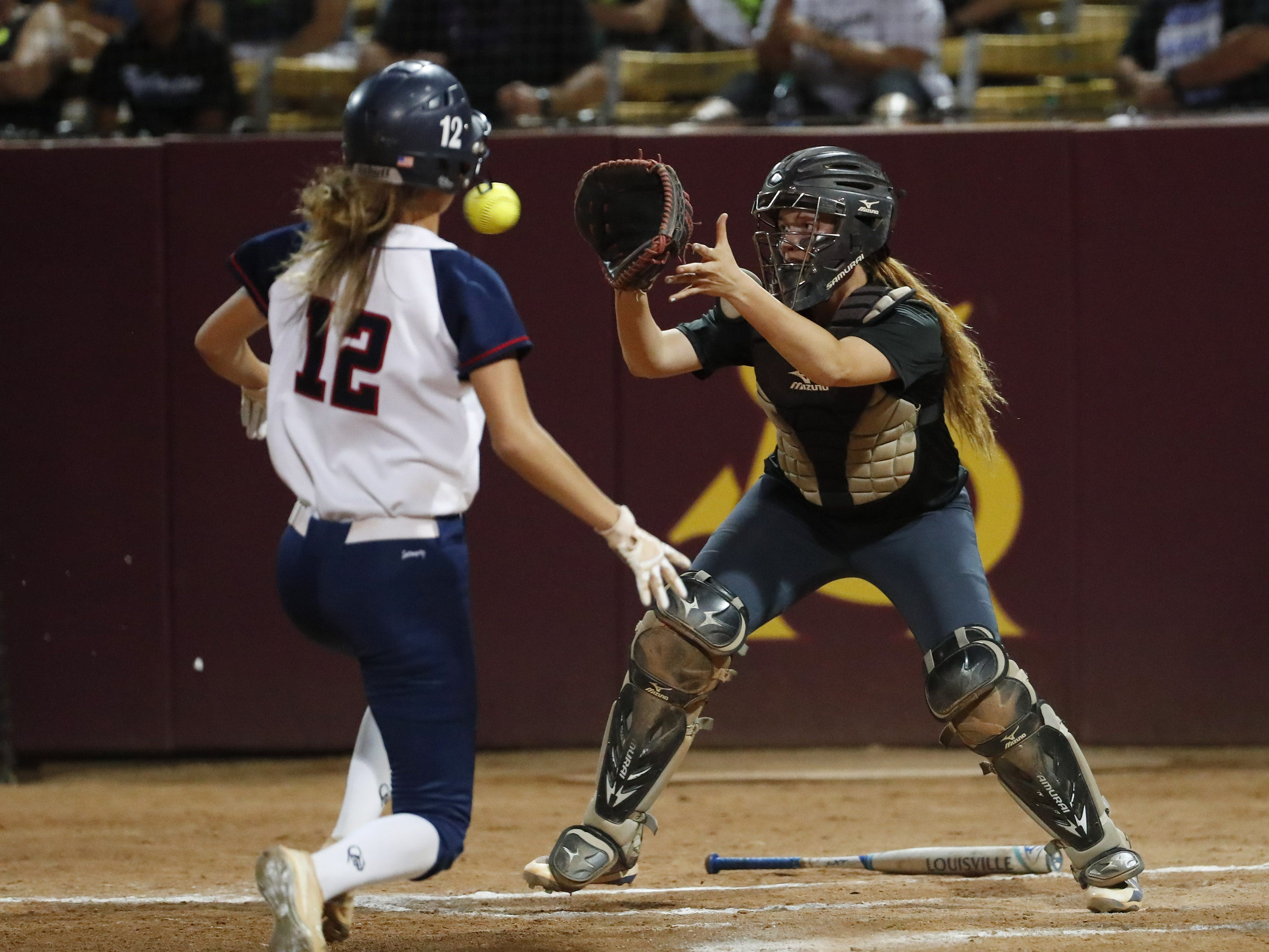 Pinnacle's Emma Bullard (12) is forced out at home by Sandra Day O'Connor catcher Jocelyn Erickson (8) during the 6A State Softball Championship in Tempe, Ariz. May 13, 2019.