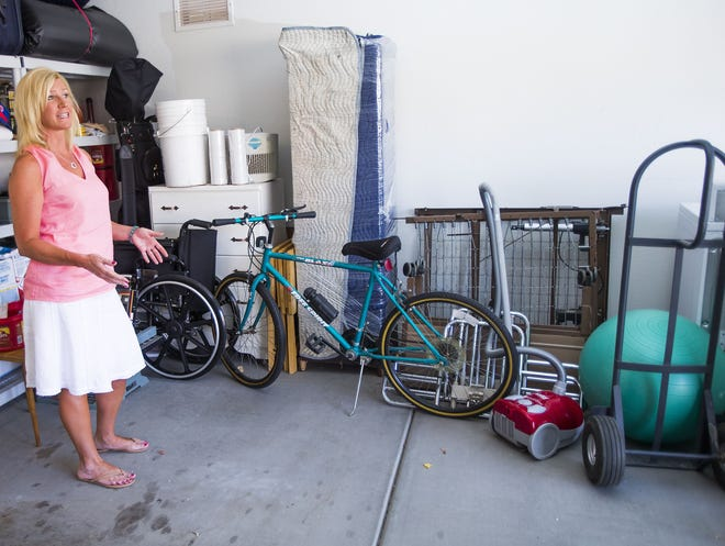Brittany Bridgeman points out items that were left behind by movers from All Star Moving and Storage when Bridgeman hired them to move her parents in Scottsdale.