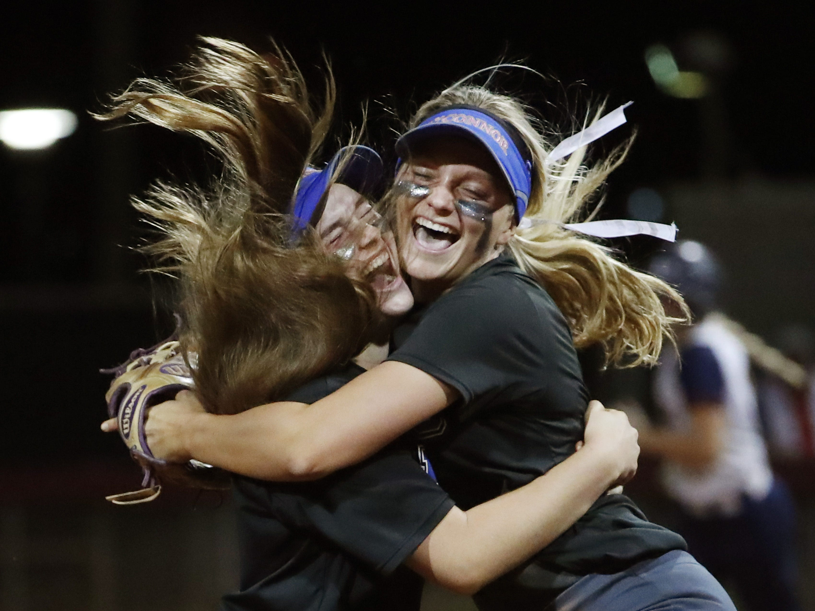 Sandra Day O'Connor pitcher Danielle Wilson (left) and  third baseman Rylee Holtorf celebrate after beating Pinnacle 6-4, winning the 6A State Softball Championship in Tempe, Ariz. May 13, 2019.