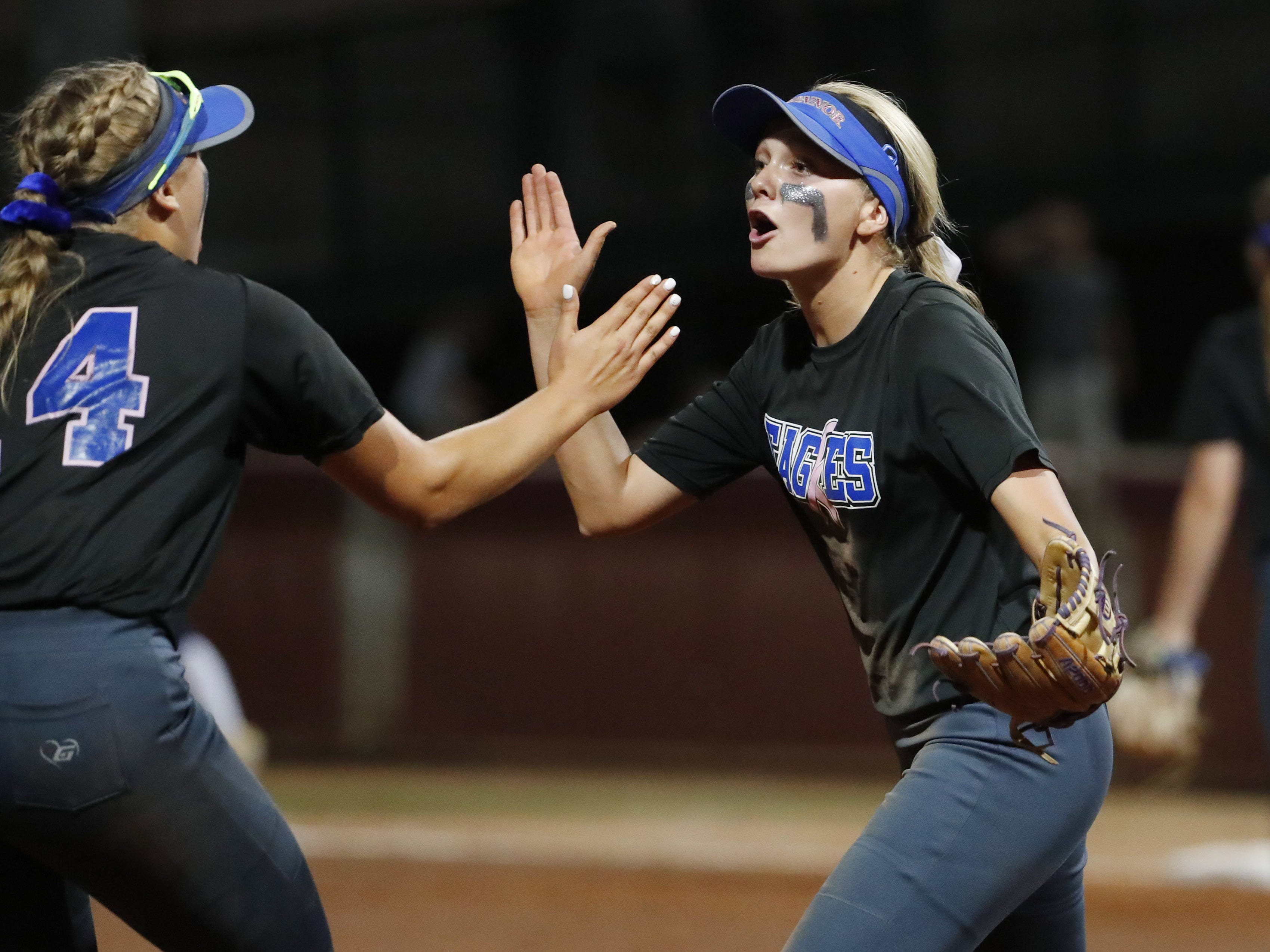 Sandra Day O'Connor third baseman Rylee Holtorf (right) is congratulated by shortstop Kaylee Erickson (14) after turning a double-play against Pinnacle during the 6A State Softball Championship in Tempe, Ariz. May 13, 2019.