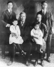 Jue Joe (center) worked on the railroad. He and his wife are flanked by their two sons born in China. Standing on the right is Robert Yen's grandfather. Jue Joe's daughters (seated) were born in America.