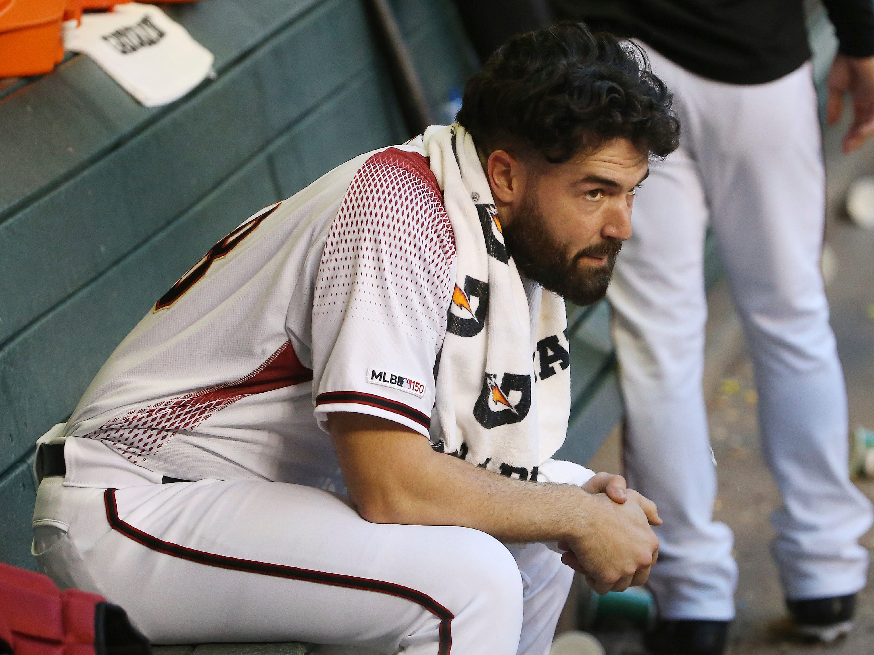 Arizona Diamondbacks starting pitcher Robbie Ray sits in the dugout after giving up two runs to the Pittsburgh Pirates during the first inning of a baseball game Monday, May 13, 2019, in Phoenix.