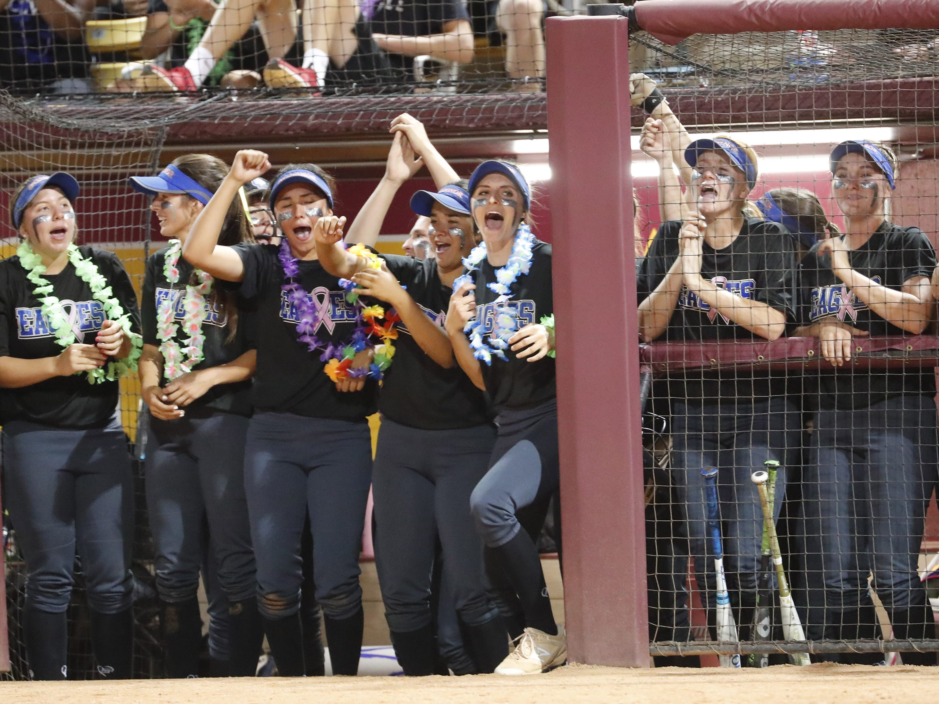 Sandra Day O'Connor players cheer for their team against Pinnacle during the 6A State Softball Championship in Tempe, Ariz. May 13, 2019.