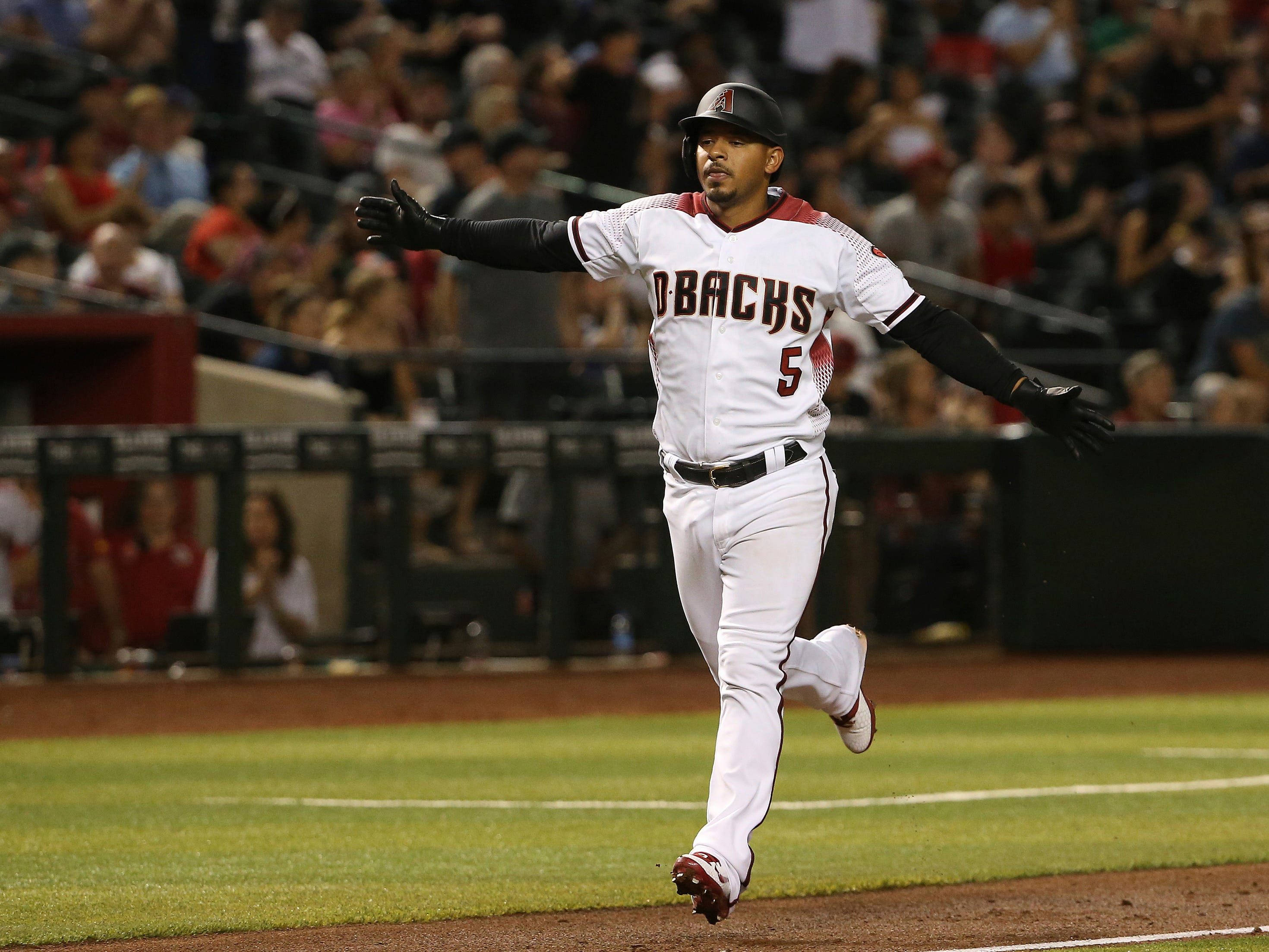 Arizona Diamondbacks' Eduardo Escobar celebrates his home run against the Pittsburgh Pirates during the fourth inning of a baseball game Monday, May 13, 2019, in Phoenix.