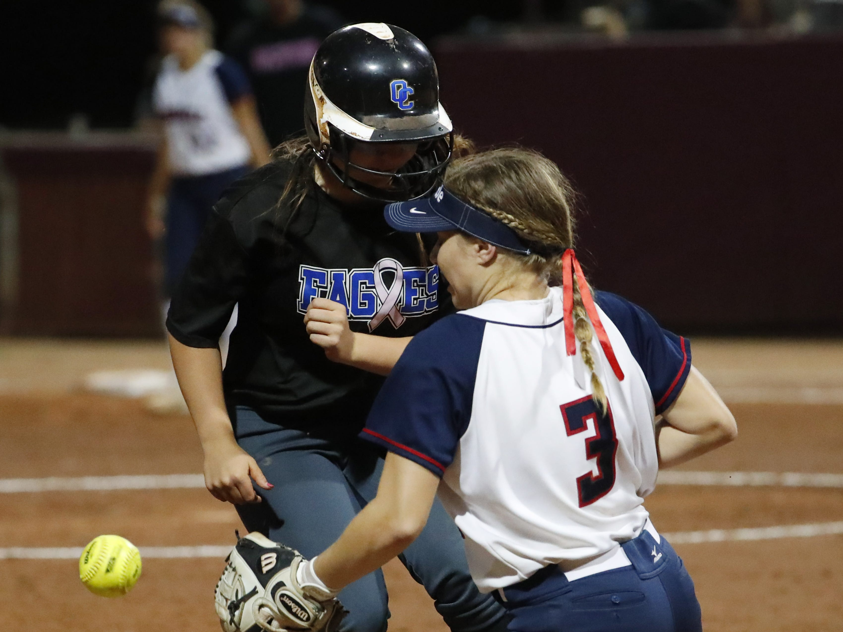 Sandra Day O'Connor's Lela Allen (15) slides in safely at third base as the ball gets away from Pinnacle third baseman Grace Rudolph (3) during the 6A State Softball Championship in Tempe, Ariz. May 13, 2019.