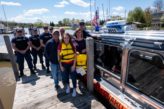 Members of the U.S. Coast Guard, St. Clair County Sheriff's Department and staff from the St. Clair Harbor stand for a photo on a dock in the harbor Tuesday, May 14, 2019. Through a partnership with the Sea Tow Foundation, the St. Clair Harbor has received nearly 50 life jackets that can be borrowed.