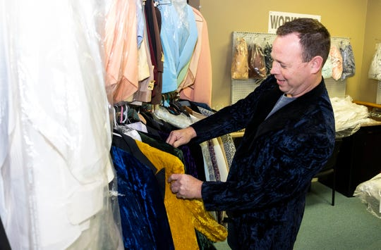 Gene Gunnery, owner of Now and Then Formal Wear, digs through racks of vintage tuxedos Tuesday, May 14, 2019, in his shop in Marysville.