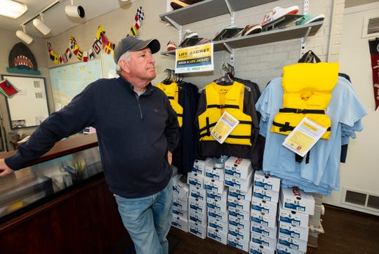 Harbormaster Dave Shorkey stands near a rack of life jackets and T-shirts Tuesday, May 14, 2019, at the St. Clair Harbor. Through a partnership with the Sea Tow Foundation, the St. Clair Harbor has received nearly 50 life jackets that can be borrowed.