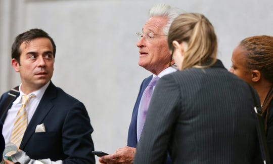 Woodstock 50 lawyer Marc Kasowitz, centert, talks to Woodstock organizer Gregory Peck, left, outside of the courthouse in Manhattan on Tuesday