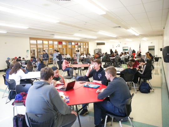 Student seat lunch inside Spackenkill High School's cafeteria on May 10, 2018.