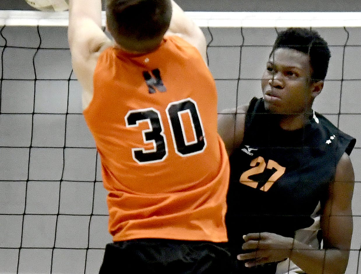 Central York's Prince Gabriel returns with Northeastern's Joel Braswell defending in the York-Adams boys' volleyball championship match at Dallastown Tuesday, May 14, 2019. Bill Kalina photo