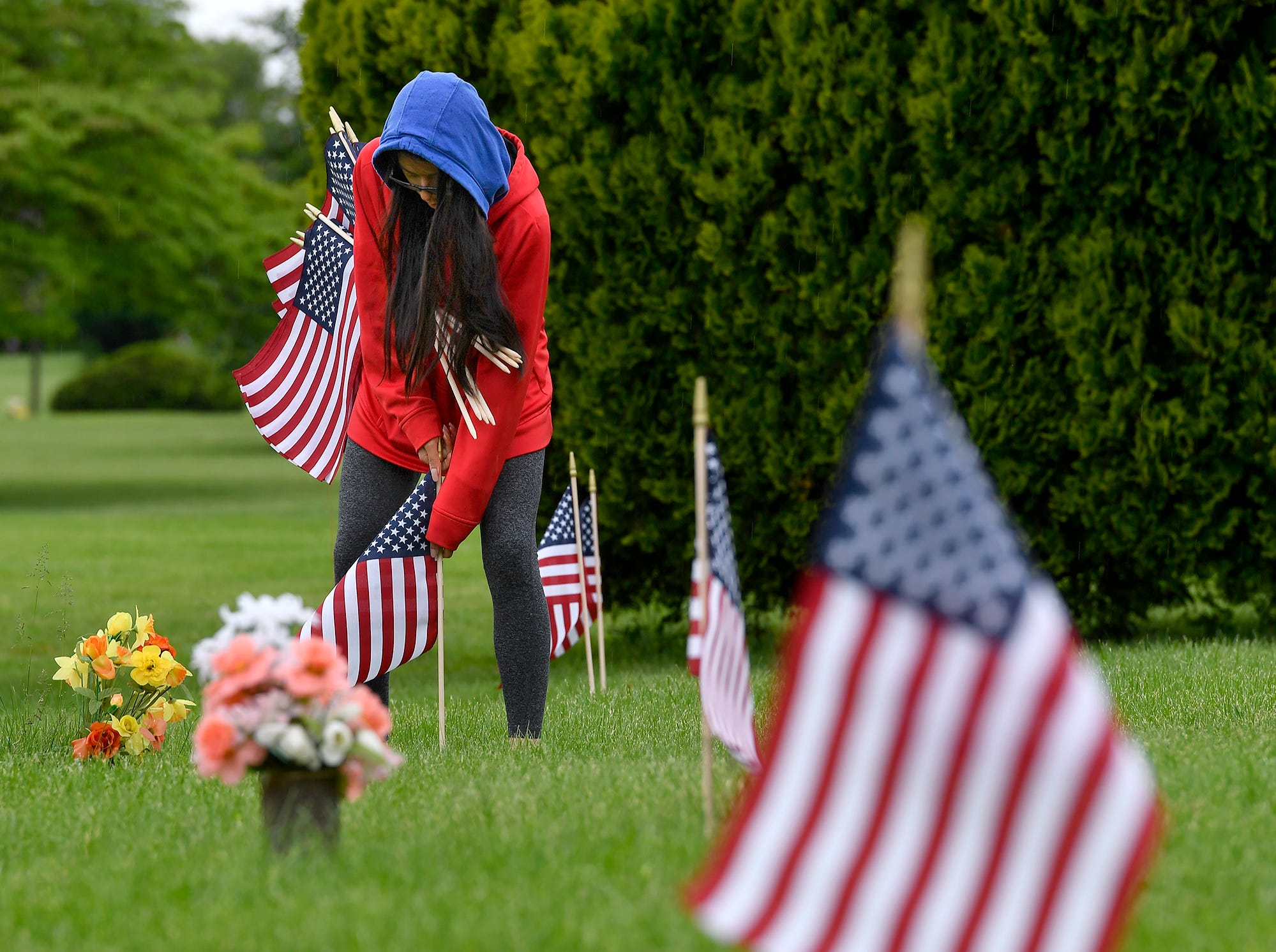 Tia Drebot, 17, helps Gold Star mother Deb Etheridge, not shown, place flags on veteran graves at Prospect Hill Cemetery in preparation for Memorial Day, Monday, May 13, 2019. Drebot and two other National Honors Society members from Dover High School assisted in the flag placing.John A. Pavoncello photo
