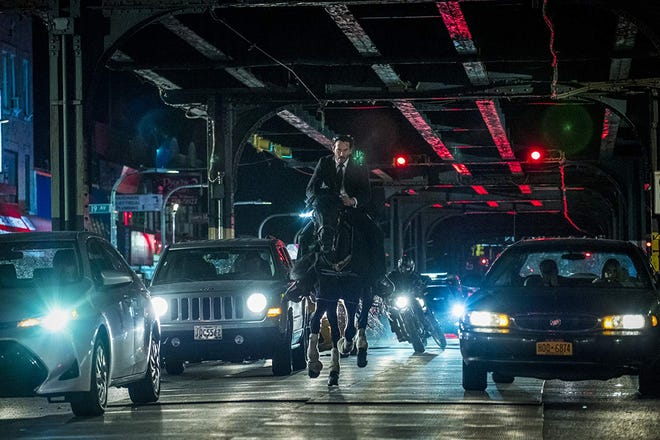 """Keanu Reeves stars in """"John Wick 3 - Parabellum."""" The movie opens May 16 at Regal West Manchester."""