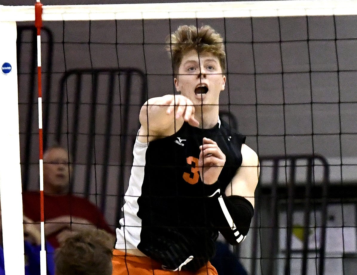 Central York's Kyle Mehl fires a shot over Northeastern's Nate Wilson in the York-Adams boys' volleyball championship match at Dallastown Tuesday, May 14, 2019. Bill Kalina photo