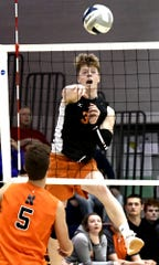 Central York's Kyle Mehl fires a shot over Northeastern's Nate Wilson on Tuesday, May 14. For the season, Mehl has 227 kills, 59 blocks, 42 aces, 172 digs and 152 assists. Bill Kalina photo