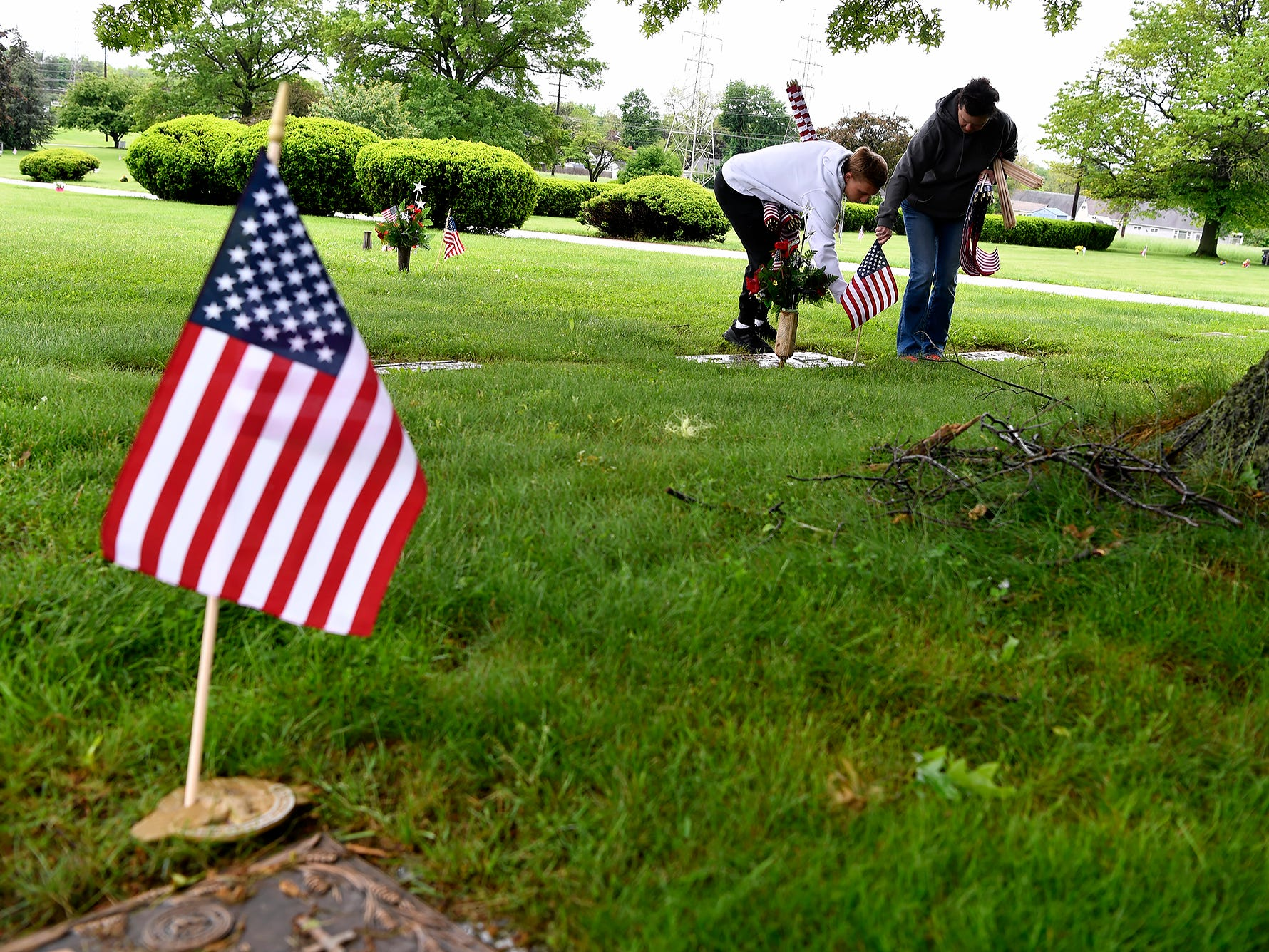 Gold Star mother Deb Etheridge and several volunteers place flags on veteran graves at Prospect Hill Cemetery in preparation for Memorial Day, Monday, May 13, 2019.John A. Pavoncello photo