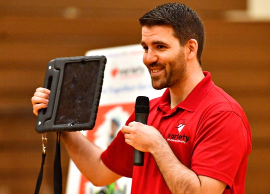 Zach Marsh, of Variety, the Children's Charity, based in Pittsburg, discusses the communication devices before presenting them to children with disabilities and their families at York Learning Center in North York, Tuesday, May 14, 2019. Dawn J. Sagert photo