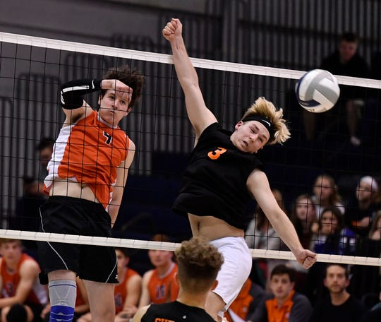 Matthew Minkin of Central York hits the ball past Noah Chojnacki of York Suburban during the York-Adams League boys' volleyball semifinal game, Monday, May 13, 2019.