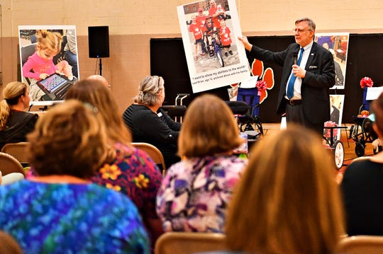 Charles LaVallee, of Variety, the Children's Charity, based in Pittsburg, shares numerous stories with the audience prior to presenting adaptable equipment and communication devices to children with disabilities at York Learning Center in North York, Tuesday, May 14, 2019. Dawn J. Sagert photo