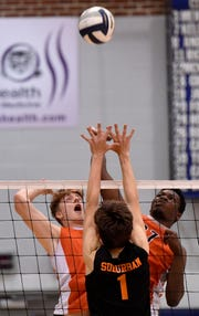 Central York's Kyle Mehl, left, and Prince Gabriel battle for the ball above the net with York Suburban's Trevor Culbertson during the York-Adams League boys' volleyball semifinal game, Monday, May 13, 2019.John A. Pavoncello photo