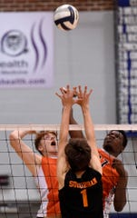 Central York's Kyle Mehl, left, and Prince Gabriel battle for the ball above the net with York Suburban's Trevor Culbertson during the York-Adams League boys' volleyball semifinal game, Monday, May 13, 2019.
