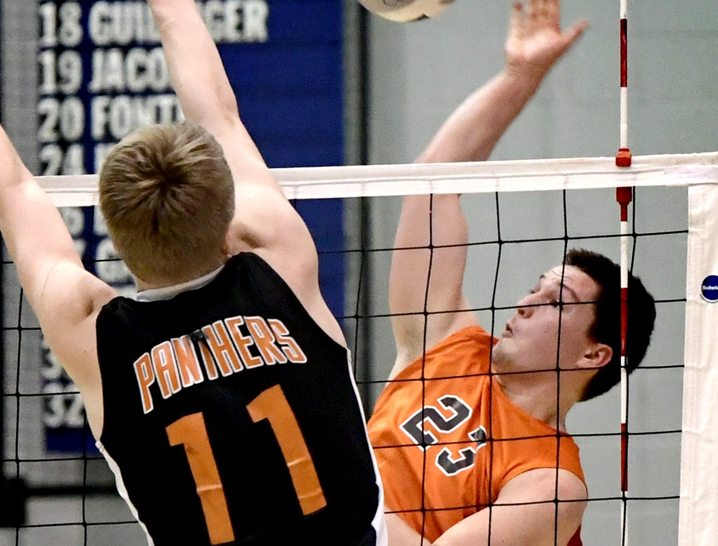Northeastern's Kyle Williams eyes a return with Central York's Braden Richard defending in the York-Adams boys' volleyball championship match at Dallastown Tuesday, May 14, 2019. Bill Kalina photo