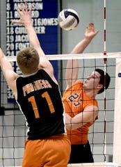 Northeastern's Kyle Williams eyes a return with Central York's Braden Richard defending in the York-Adams League boys' volleyball playoff championship match at Dallastown on Tuesday. Northeastern won a five-set thriller, 25-23, 16-25, 25-27, 25-22, 15-10.