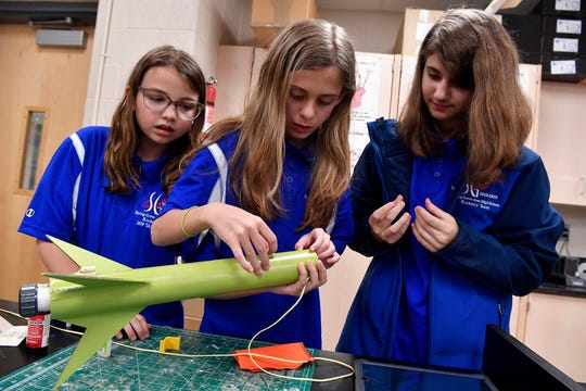 Alyssa Beyer, 11, left, Hailey Graff, also 11, and Finley Ritenour, 12, right of the Intermediate School rocket team at Spring Grove School District prepare their rocket upcoming Team America Rocketry Challenge in Virginia, Monday, May 13, 2019.John A. Pavoncello photo
