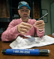 Bill Hynes, CEO and founder of UFD, with a strand of fiber optic cable, one of many that is encased in a cable bundle like the section in the frame below.