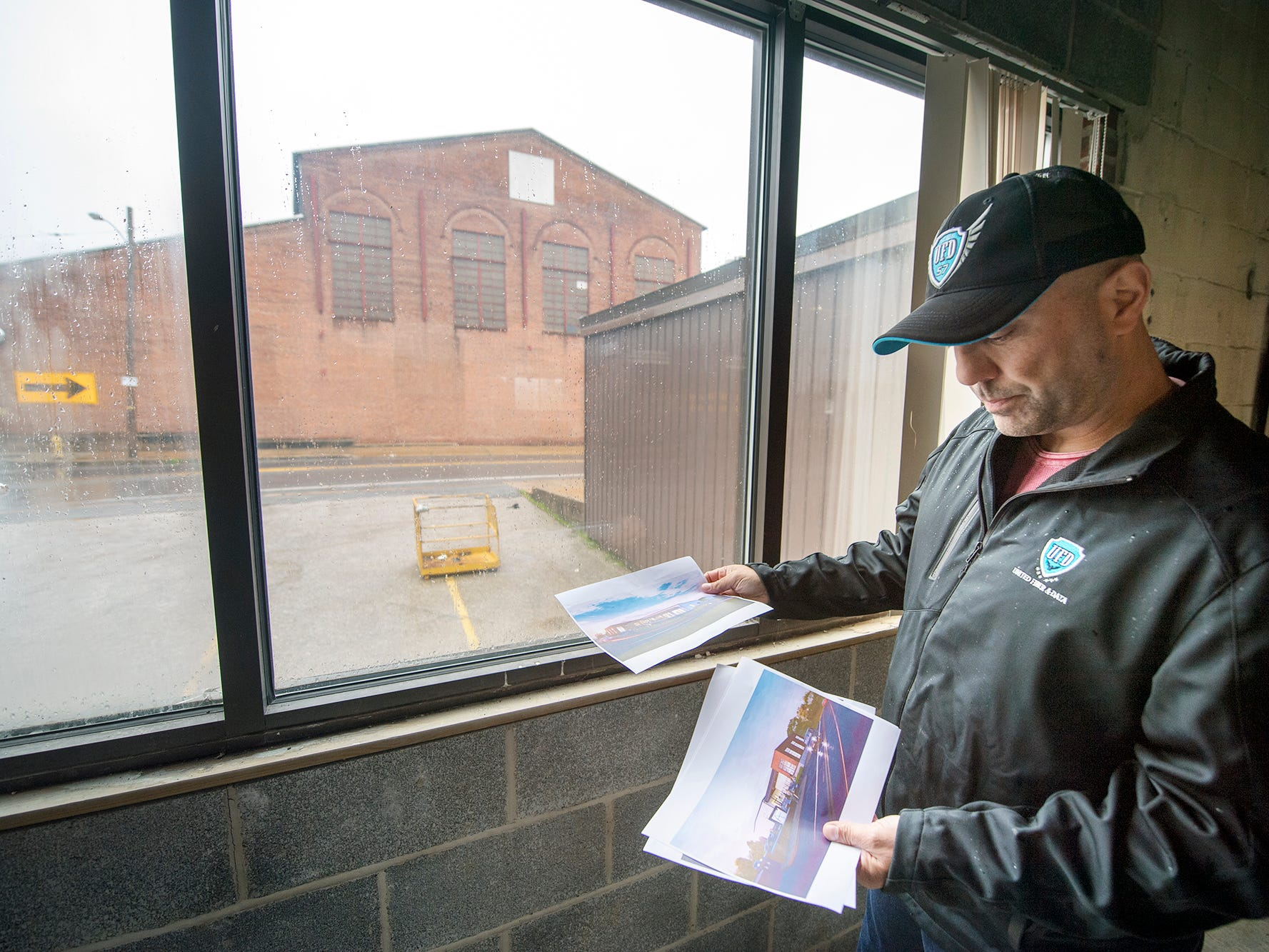 Bill Hynes, CEO and founder of UFD, looks over artist renditions in a recently gutted building in the former Metso complex. In the background, is one of the buildings that is most visible when entering York from Loucks Mill Road.