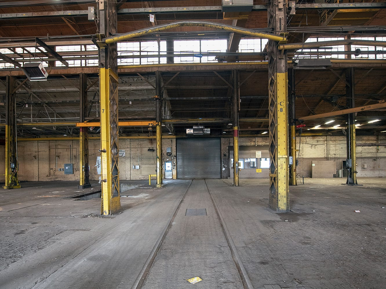 Looking inside one of the former Metso buildings with railroad tracks running through the building that Bill Hynes, CEO and founder of UFD plans on renovating.