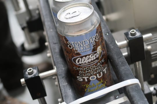 Stoneyard Brewing's Abbott's Chocolate Almond Custard Stout rolls off the canning line Tuesday at the brewery in Brockport.